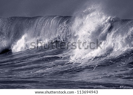 Big ocean wave crashes on to the Portuguese coast - Toned black and white