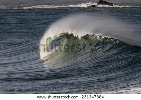 Big ocean wave with tube and spray. North of Portugal. - stock photo
