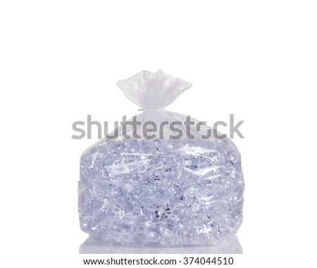 Big of ice cubes in clear plastic bag isolated on white with reflection. - stock photo