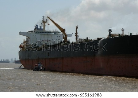 Big oil tanker during unloading operation in the sea