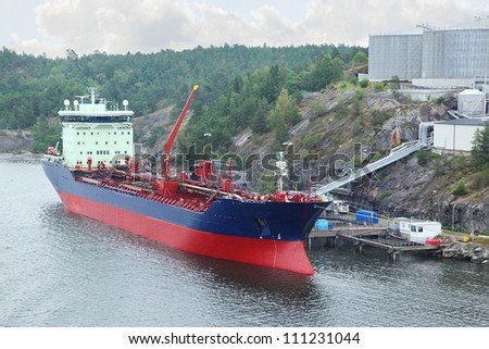 Big oil tanker with crane refueling - stock photo