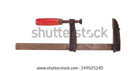 Big old metal clamp isolated on white - stock photo