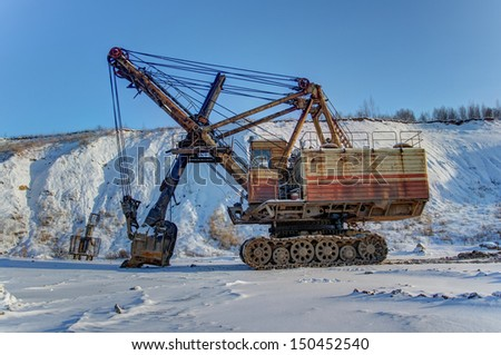 Big old mining excavator in winter - stock photo