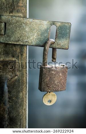Big old rusty open padlock  - stock photo