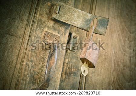 Big old rusty open padlock,focus at lock,padlock. - stock photo