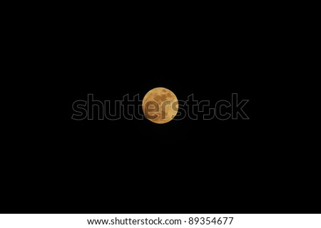 big orange full moon shines in the night - stock photo