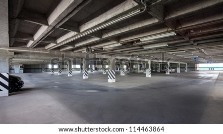 big parking area in basement of building - stock photo