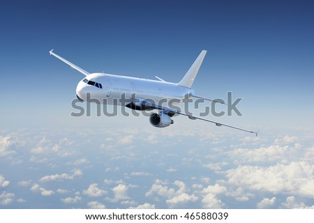 Big Passenger airplane flying over cloudy sky - stock photo