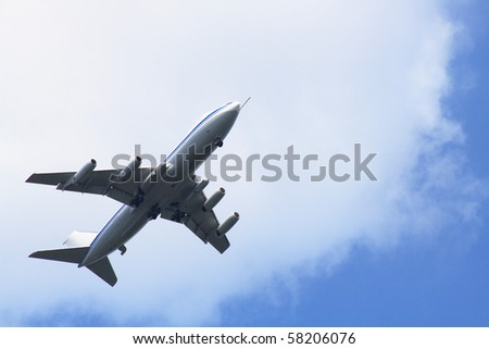 Big passenger airplane on background with blue sky and clouds