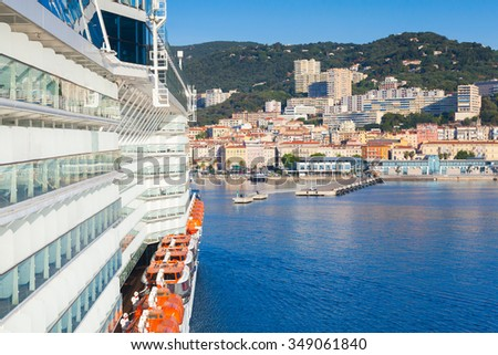 Big passenger cruise ship enters the port of Ajaccio, Corsica island, France. View from a captain bridge wing - stock photo