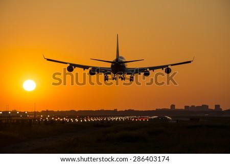 Big passenger plane is preparing for landing. - stock photo