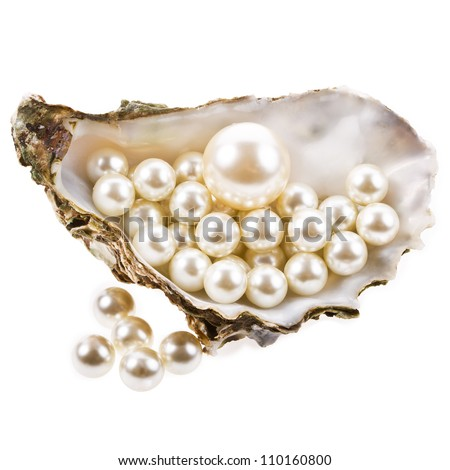 Big pearl in an oyster shell and small pearls , isolated on a white background . - stock photo