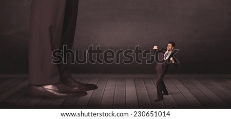 Big person with small businessman concept on background