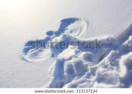 Big picture of the snow angel on January clean snow - stock photo