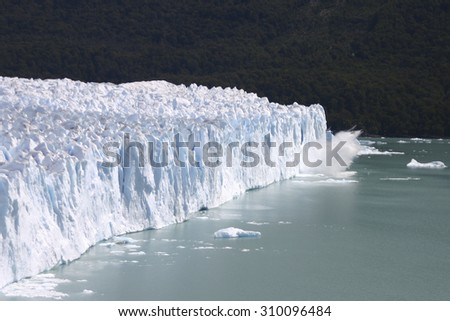 Big piece of the Glacier Perito Moreno in Patagonia falling into the glacier lake. Argentina 2006 - stock photo