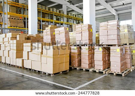 Big pile of boxes in distribution warehouse  - stock photo