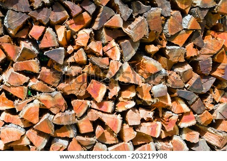 Big pile of cut firewood background texture logs - stock photo