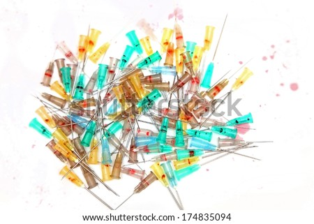 Big pile of disposable used medical needles - stock photo