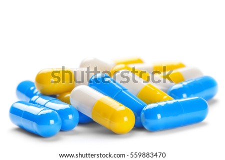 big pile of medical pills blue and yellow color