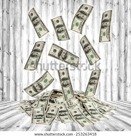 big pile of money. dollars on the wood background