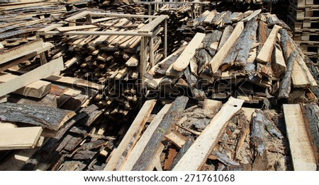 Big pile of unsorted planks on sawmill yard - stock photo