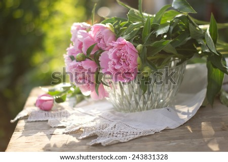 Big pink peonies in a basket on the setting sun shabby ?hic style - stock photo