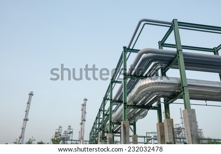 Big pipes on iron structure in Petrochemical oil refinery plant - stock photo