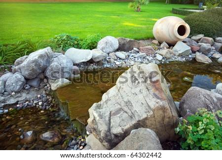 Big pitcher in park. Nature design. - stock photo