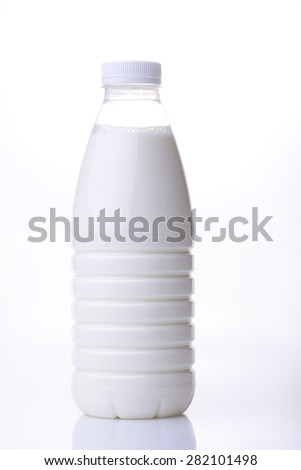Big plastic bottle of fresh useful home milk standing on white background, vertical photo - stock photo