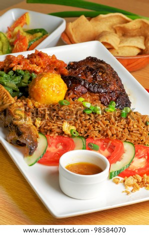 Big plate of Indonesian food - stock photo