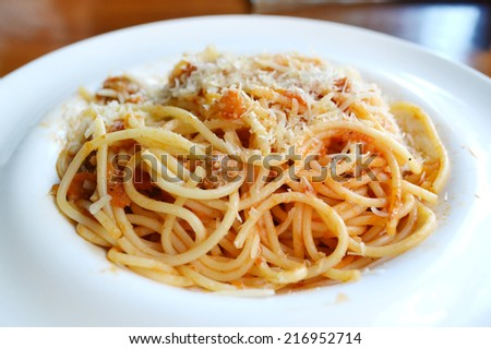 Big plate with pasta spaghetti bolognese - stock photo