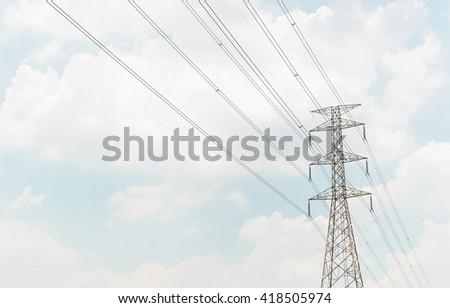 Big pole of cable power from power plant on sky with cloud - stock photo