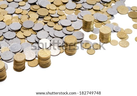 big quantity of coins yellow and gray scattered