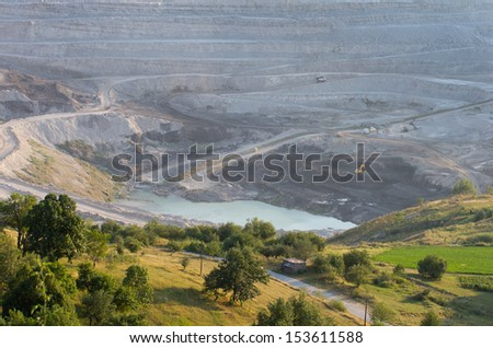 Big quarry in high mountains - stock photo