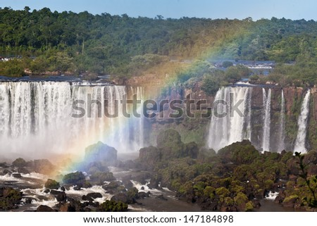 Big rainbow in front of the Iguazu Falls on the Brazilian side