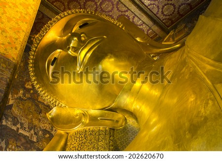 big reclining buddha is creed buddhist in thailand. - stock photo