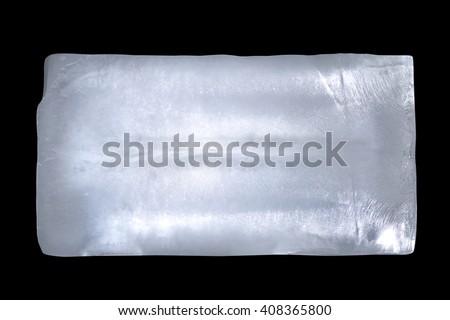 Big rectangle of ice block isolated on black - stock photo