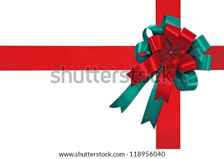 Big red and green holiday bow on white background - stock photo