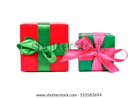 Big red and small green box with ribbons for gifts on a white background