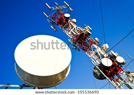Big red and white antenna with blue sky - stock photo