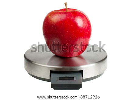 Big red apple on a scales isolated over white background. Diet concept - stock photo