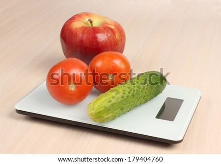 Big red apple on electronic scales - stock photo