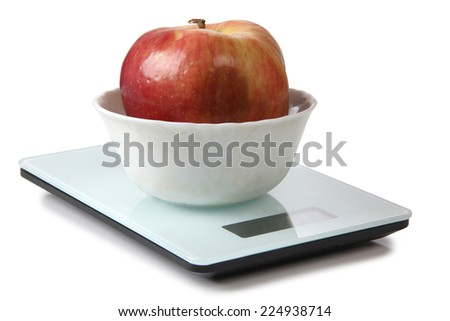 Big red apple on electronic scales