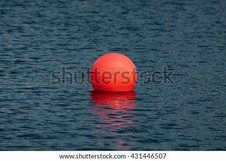 Big red ball in the lake