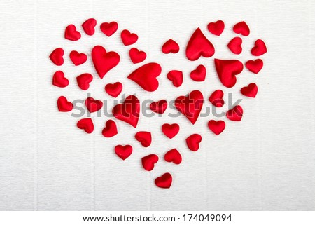 Big red heart formed by a bunch of hearts of various sizes. Vale - stock photo