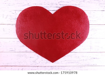 Big red heart on wooden background - stock photo
