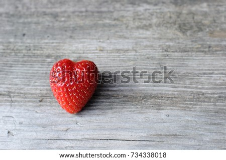 big red strawberry is like a heart