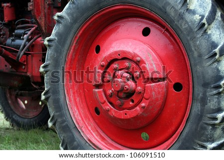 Big red tractor wheel - stock photo