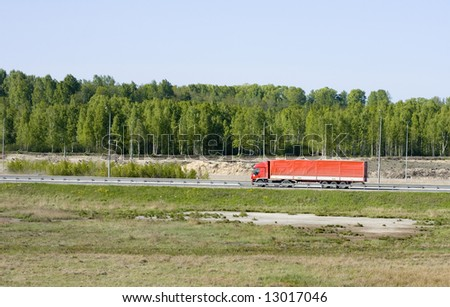 "big red truck shot from far away - rural landscape  - See similar images of this ""Business People"" series in my portfolio - stock photo"