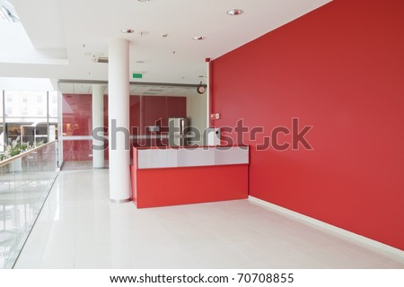 Big red wall at empty  modern mass production office